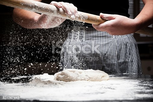 istock Flour falling off rolling pin 521267443