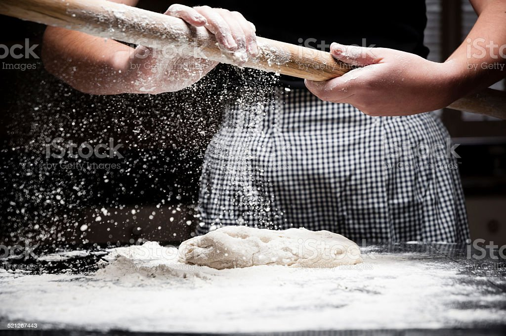 Flour falling off rolling pin stock photo