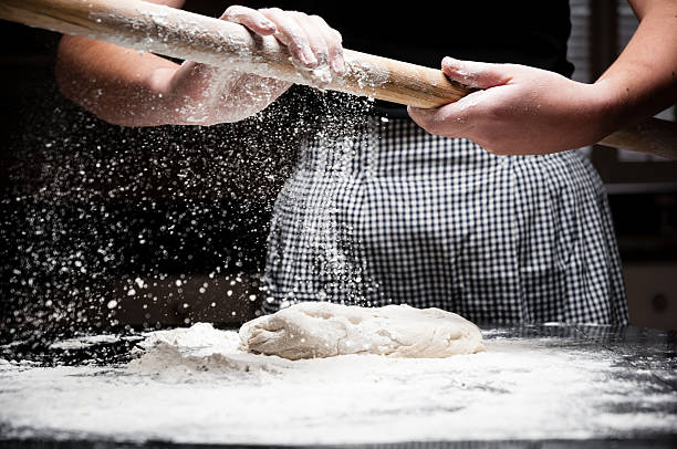 flour falling off rolling pin - kellyjhall stock pictures, royalty-free photos & images