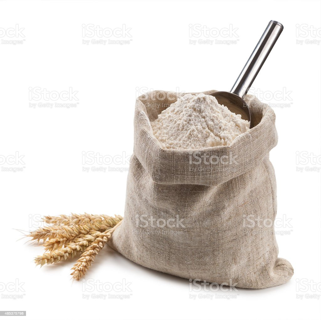 flour in a bag and spikelets isolated on white background stock photo
