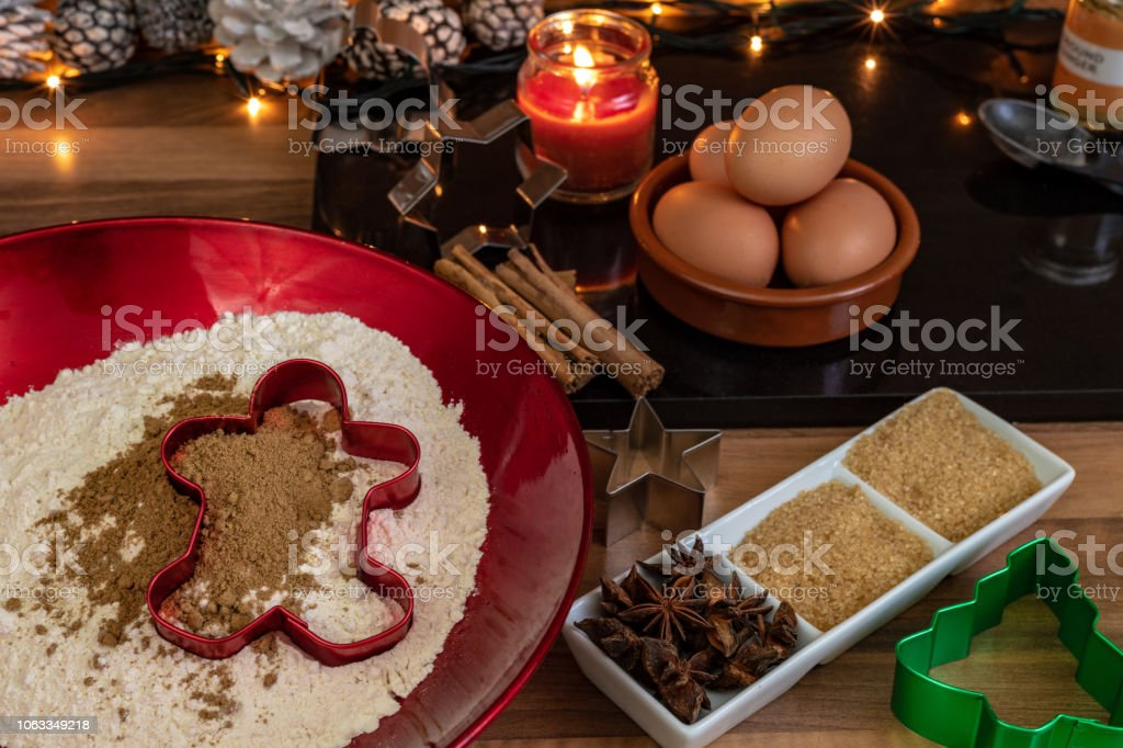 Flour in a bowl and ingredients for baking at Christmas stock photo