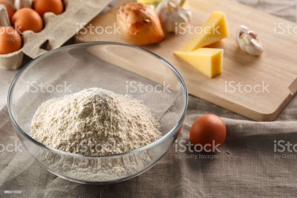 flour in a glass Cup on the background of other ingredients for dough zbiór zdjęć royalty-free
