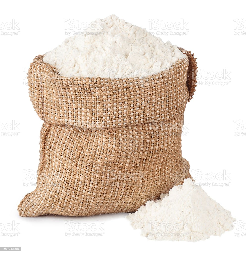 Flour in burlap sack and heap isolated on white stock photo