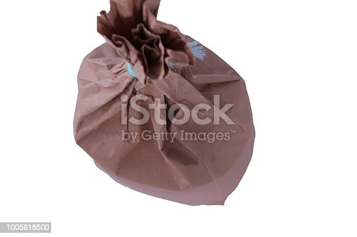 912671588istockphoto Flour in Kraft paper-pack isolated on white background 1005618500