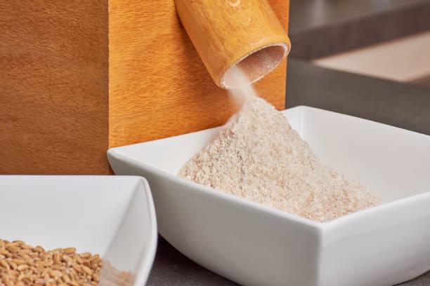 flour mill with fresh spelt flour stock photo