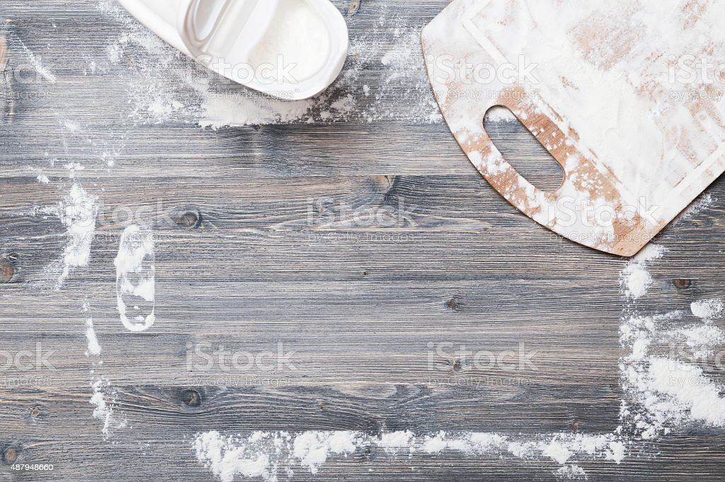 Flour on a wooden table stock photo