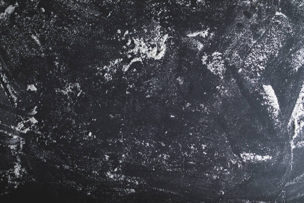 Flour on black table background stock photo