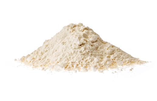 heap of Flour on white background