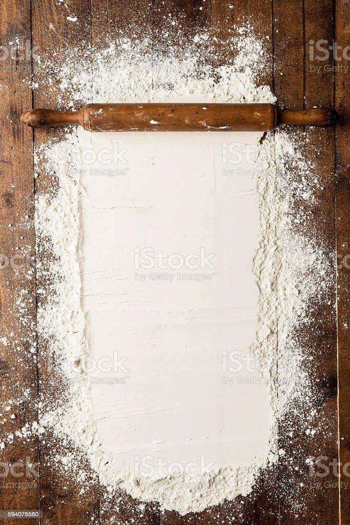 Flour over kitchen table stock photo