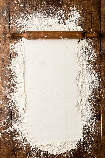 Flour over kitchen table stock photo