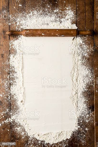 Flour Over Kitchen Table Stock Photo - Download Image Now