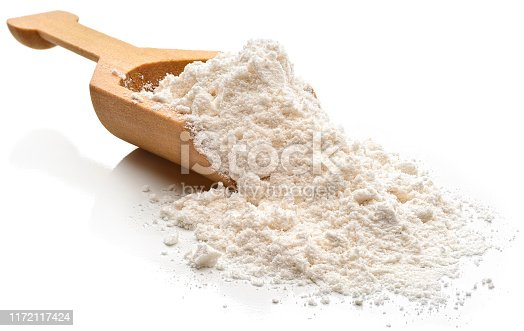 Flour in a serving scoop.  Isolated on a white background.