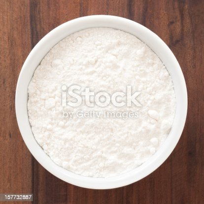 Top view of white bowl full of flour