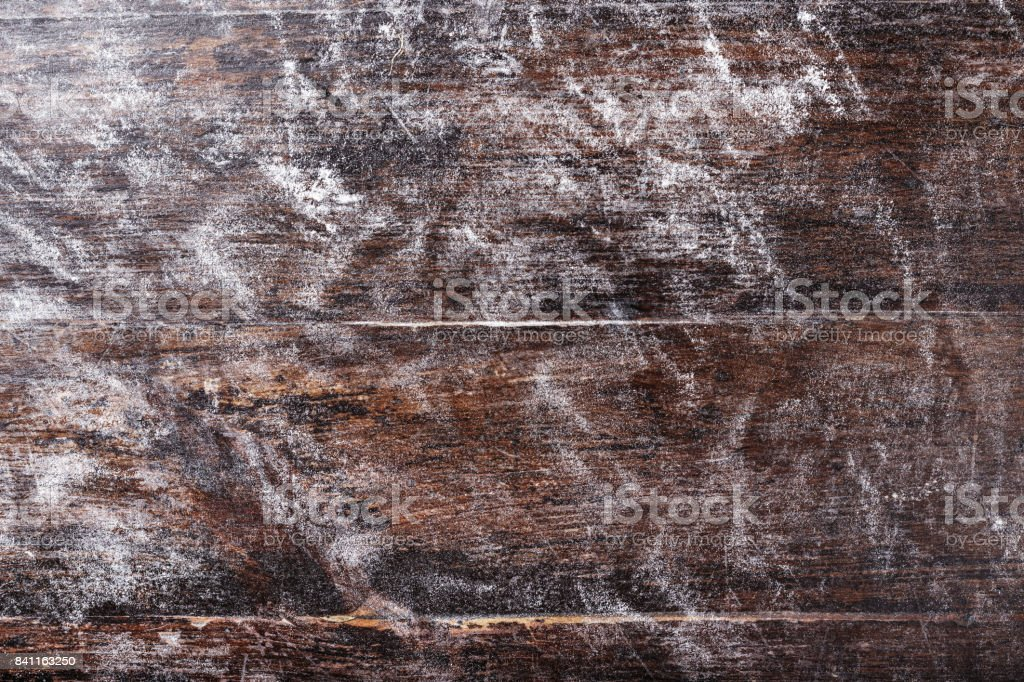 flour scattered on a wooden background stock photo