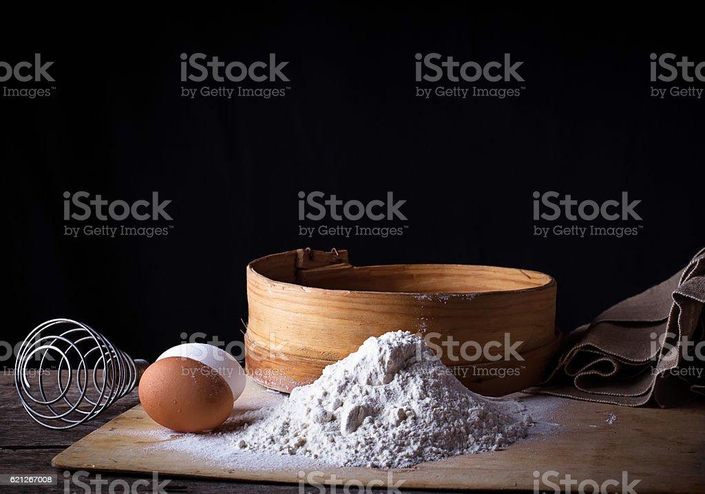 Flour, sieve and eggs stock photo