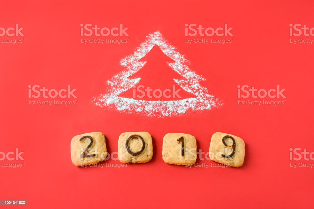 Christmas Images 2019 Download.Flour Silhouette Christmas Tree With Cookies Digits 2019 On Red Background Delicious Bakery Sweet Confectionery Christmas Card Idea Of Merry New Year