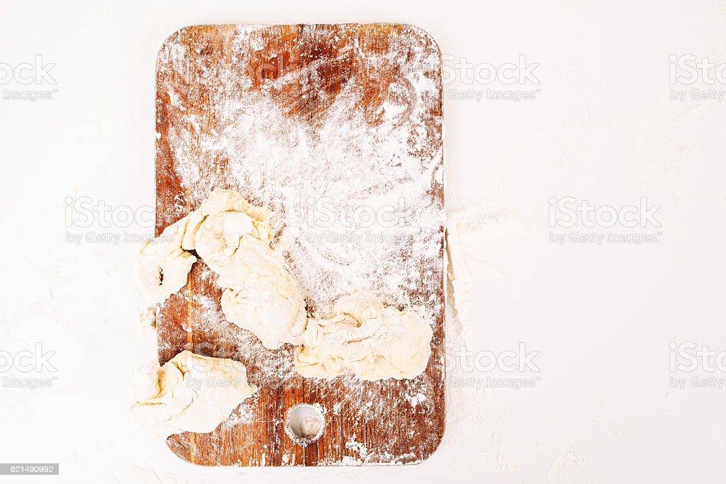 Floured cutting board with raw dough top view Lizenzfreies stock-foto