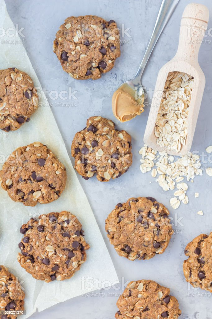 Flourless peanut butter, oatmeal and chocolate chips cookies, vertical stock photo