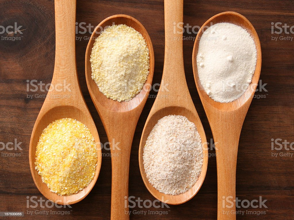 Flours and spoons stock photo