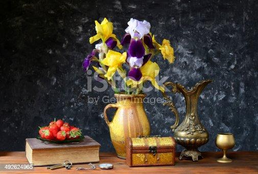 istock Flovers ceramic vase and fresh strawberries 492624965