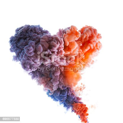 istock Flow of colorful paint underwater 695577330