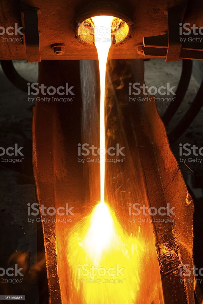 flow of melted glass from furnace stock photo