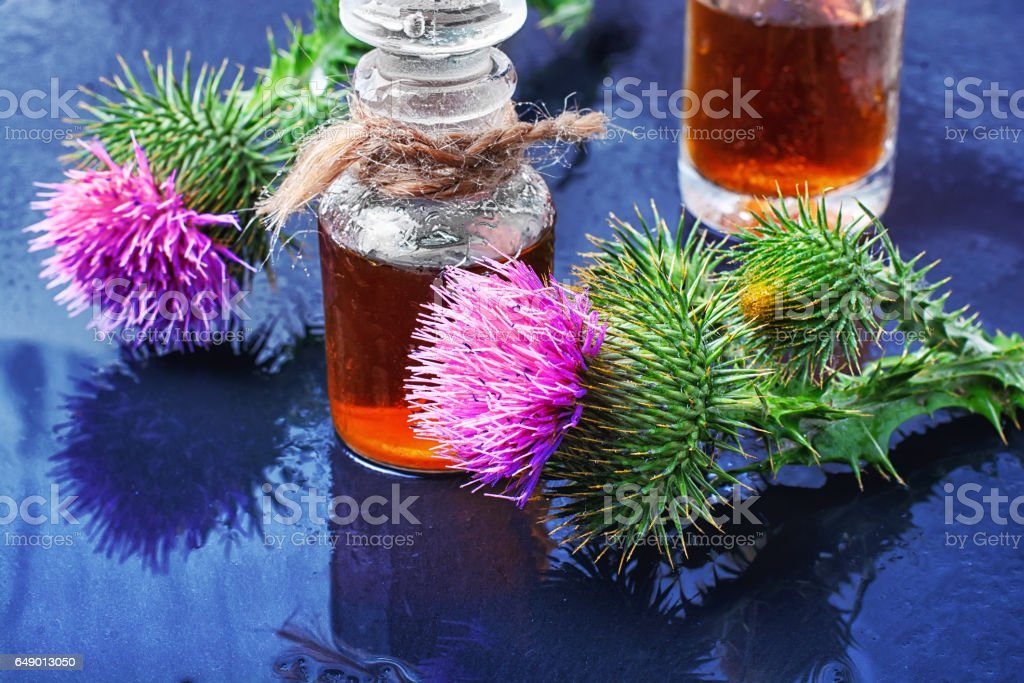Flower and burdock extract stock photo