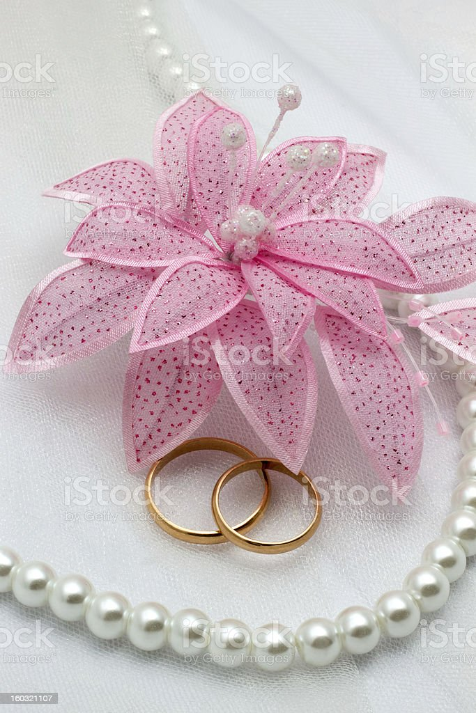 Flower and two gold rings on a wedding background royalty-free stock photo