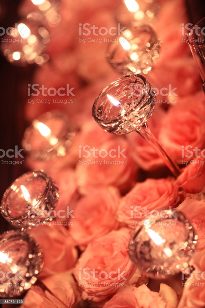 Flower arangement of roses and candle stock photo