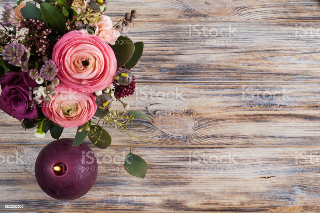 Flower arangement of roses and ranunculus stock photo