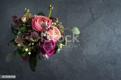 istock Flower arangement of roses and ranunculus 823595306