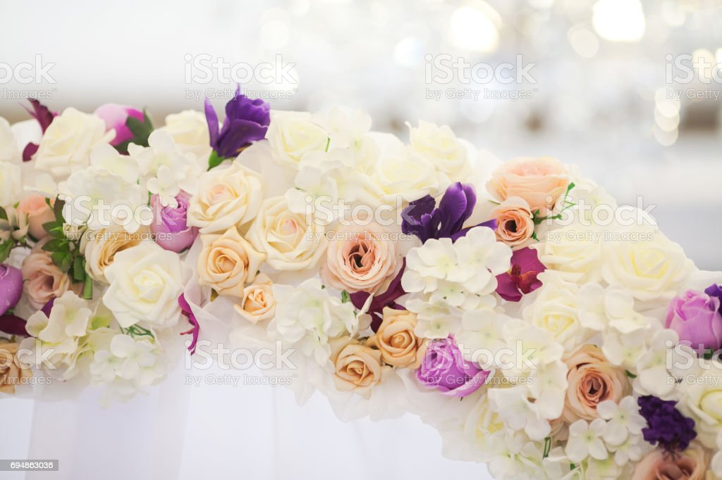 flower arch from fresh colors for a wedding ceremony at restaurant on a white background with a light wedding decor stock photo