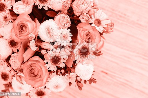 1147995495 istock photo Flower arrangement in a box of fashionable coral color. 1125870536