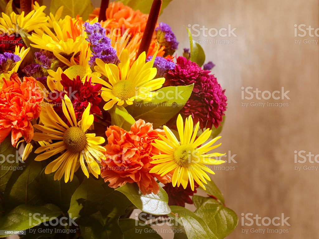 Flower Arrangement on Dark Wood stock photo