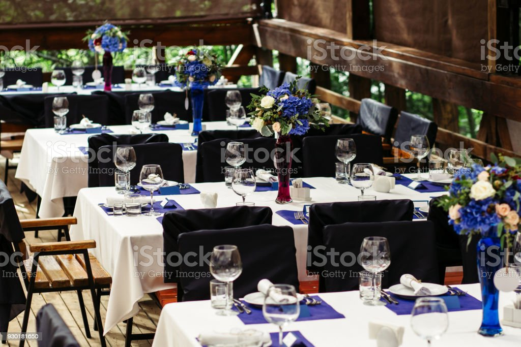 Flower arrangement on wedding table. Floral compositions with fresh roses and blue flowers-2 stock photo