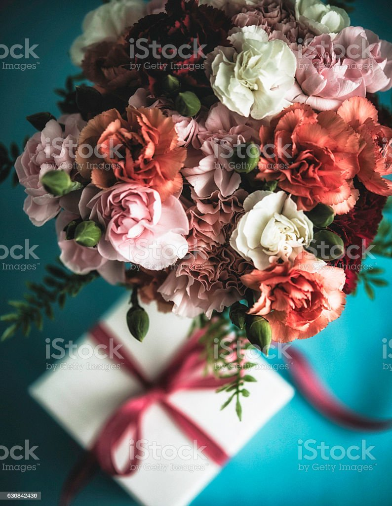 Flower arrangement with carnations, fern and gift for special...
