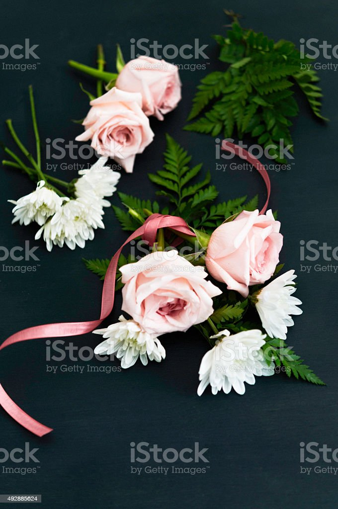 Flower arranging with roses and dahlia. Making a corsage stock photo