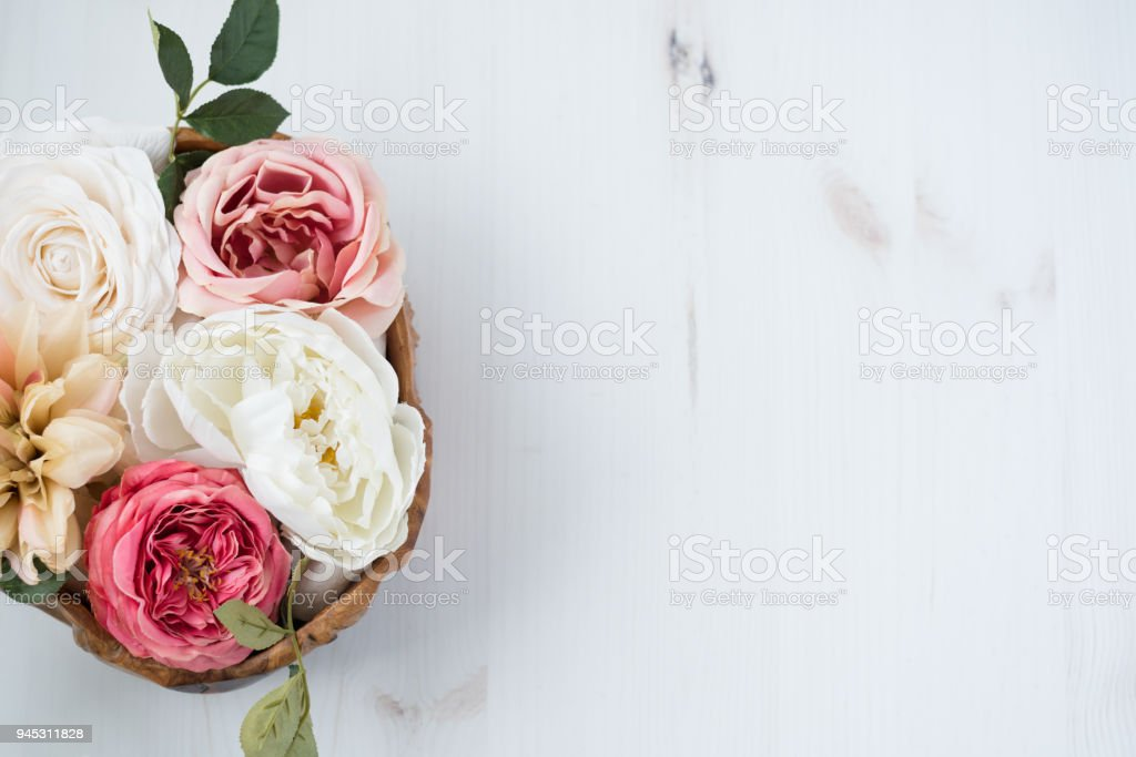 Flower arrangment over wood table royalty-free stock photo