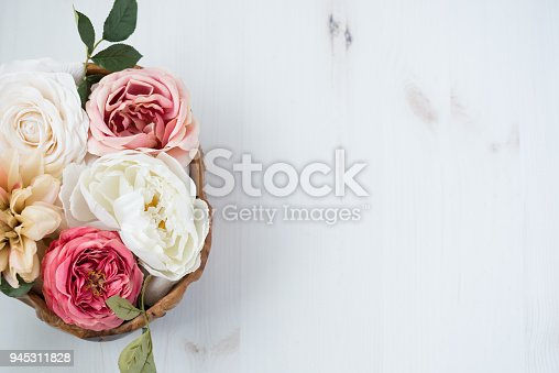 Flat lat of Flower arrangment over wood table