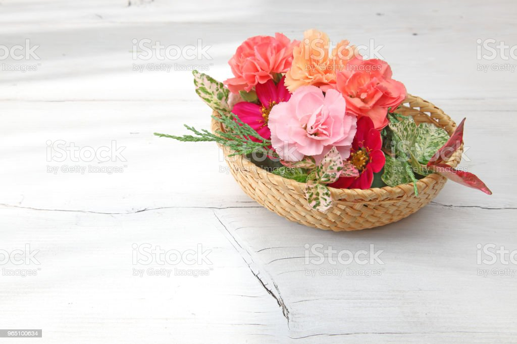 flower basket in a wooden background royalty-free stock photo