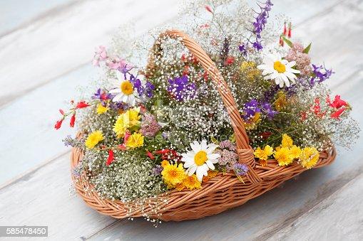 Flower basket with fresh wildflowers.