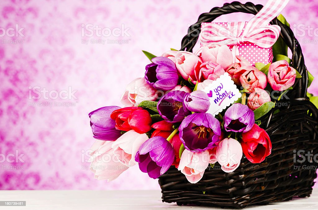 Flower Basket with Gift for Mom royalty-free stock photo