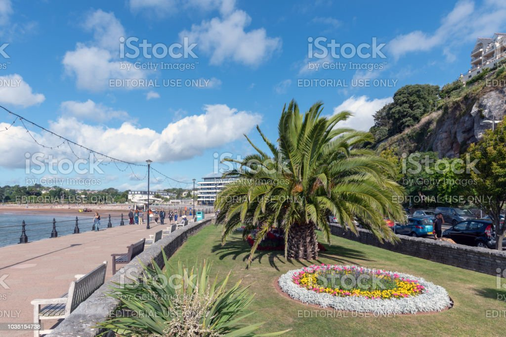 Flower bed and promenade along the seafront in Torquay, Devon stock photo