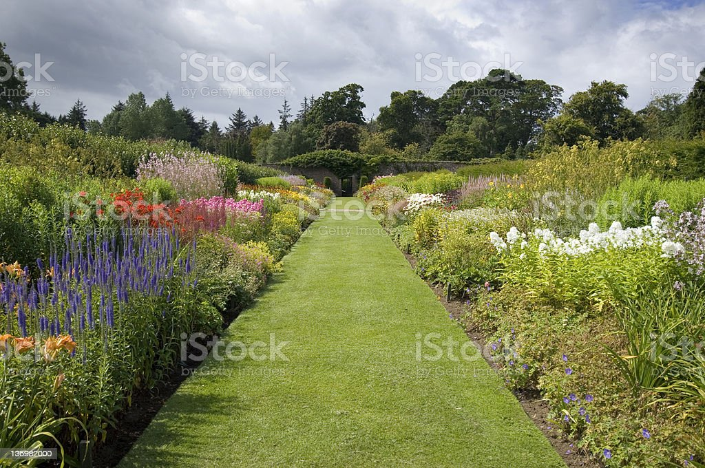 Flower bed in formal garden setting royalty-free stock photo
