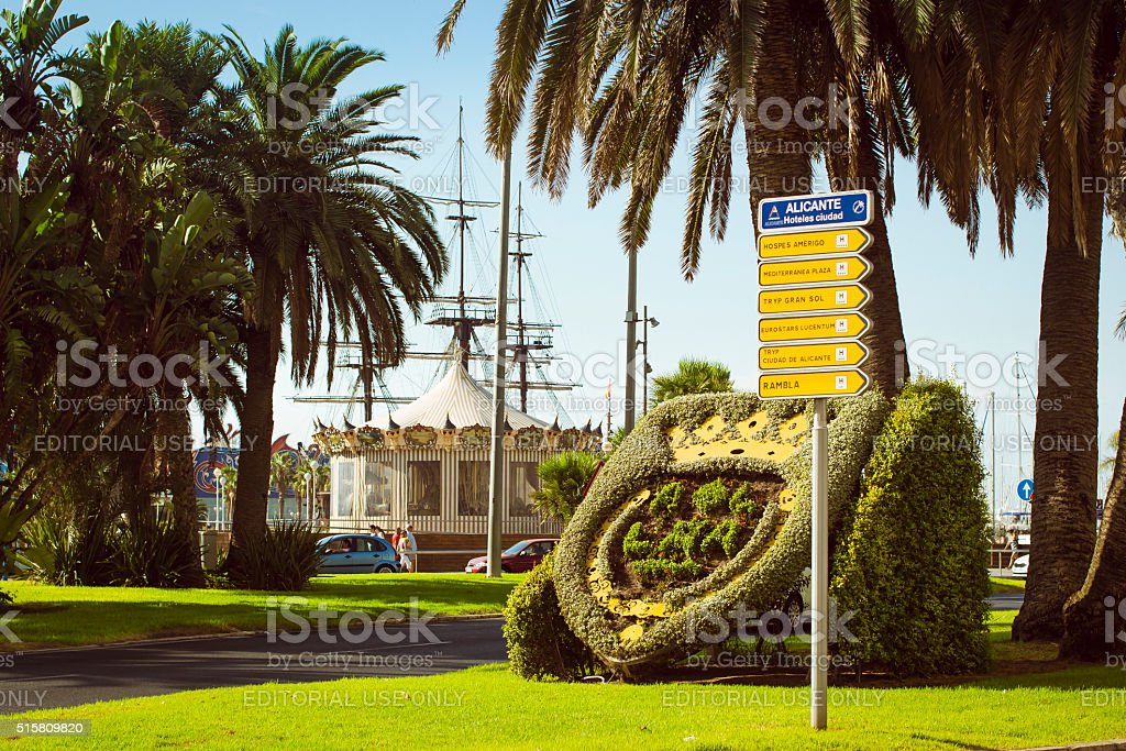 Flower bed with coat of arms on Plaza Puerta stock photo