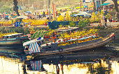 Flower boats along canal on New Year festival, HoChiMinh, Vietnam