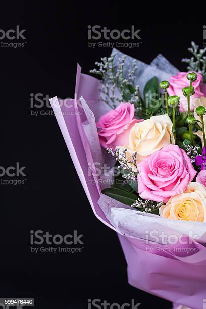 Flower bouquet wrapped with paper standing on blackbround picture id599476440?b=1&k=6&m=599476440&s=612x612&h=03dwwl1nbl6oemuo4xaylxsukxanfplso4q3 enkvws=