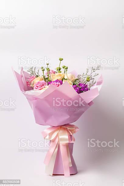 Flower bouquet wrapped with paper standing on white picture id532550538?b=1&k=6&m=532550538&s=612x612&h=jkvobanjmeggt n tbtzukpk6lvj86 jfp8la1di7uc=