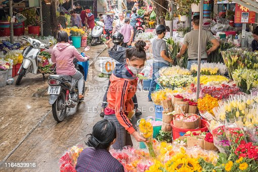 Ho Chi Minh City, Vietnam - April 12, 2019: flower vendors and buyers at Ho Thi Ky Flower Market.