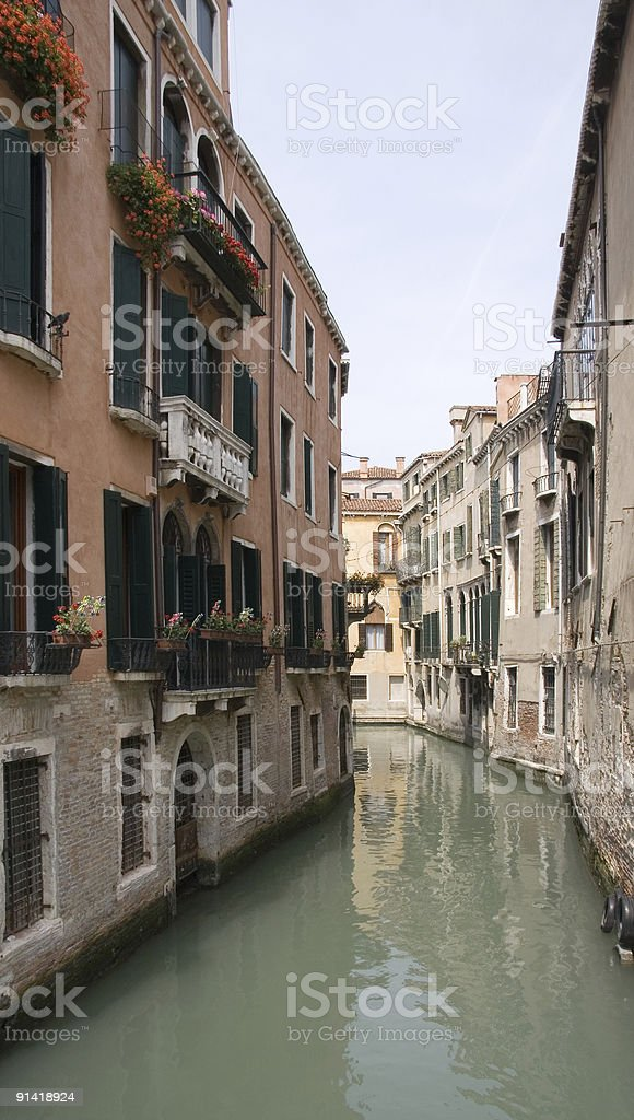 Flower Boxes on Homes by a Canal in Venice royalty-free stock photo